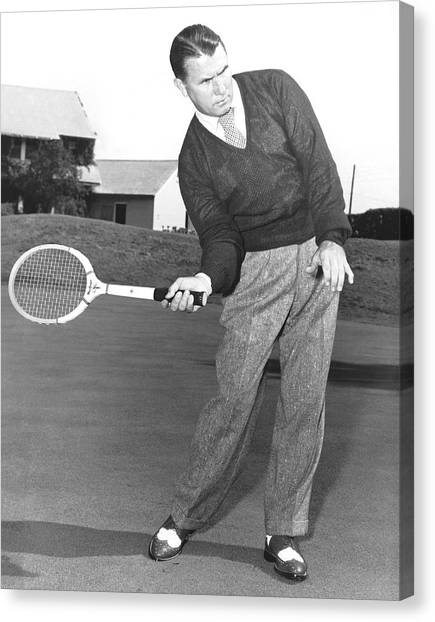Tennis Racquet Canvas Print - Man Posing With Sports Gear by Underwood Archives