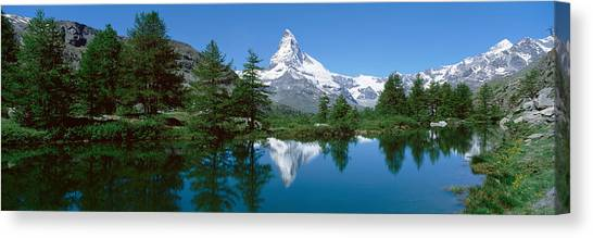 Matterhorn Canvas Print - Reflection Of A Mountain In A Lake by Panoramic Images