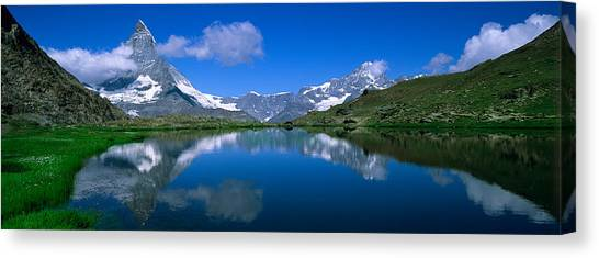 Matterhorn Canvas Print - Reflection Of Mountains In Water by Panoramic Images