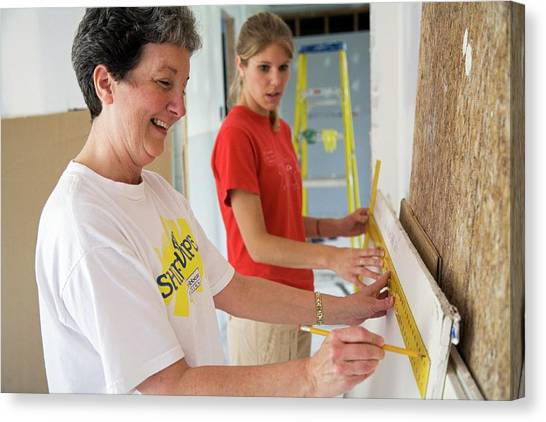 Drywall Canvas Print - Repairing Hurricane Katrina Damage by Jim West