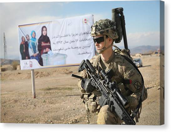 Us Troops Patrol Village In Afghanistan's Logar Province Canvas Print by Scott Olson
