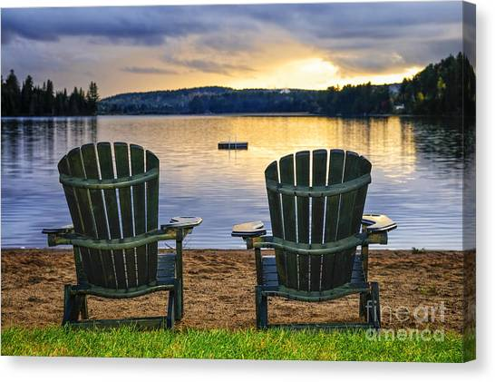Algonquin Park Canvas Print - Wooden Chairs At Sunset On Beach by Elena Elisseeva
