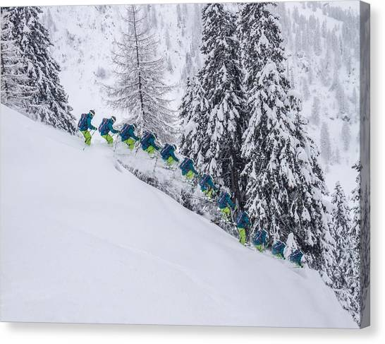 Young Male Freerider Skiing Down A Powder Slope Canvas Print by Leander Nardin