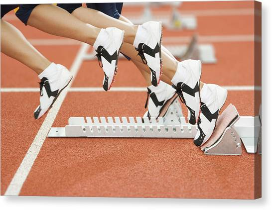 Athlete Leaving The Blocks Canvas Print by Gustoimages/science Photo Library