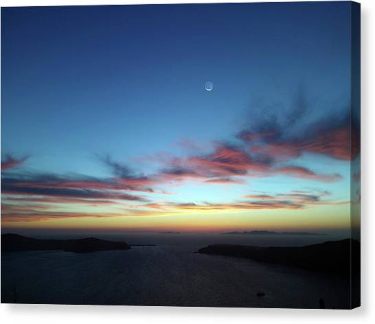 Crescent Moon In Cloudy Sky Canvas Print by Detlev Van Ravenswaay