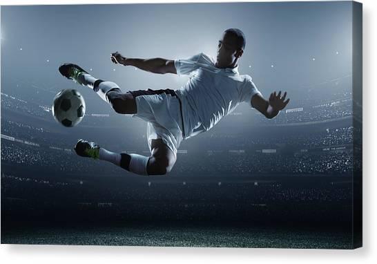 Soccer Player Kicking Ball In Stadium Canvas Print by Dmytro Aksonov