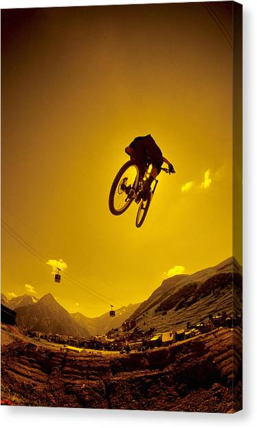 Freeriding Canvas Print - A Male Rider Mountain Bikes In Les Deux by Scott Markewitz
