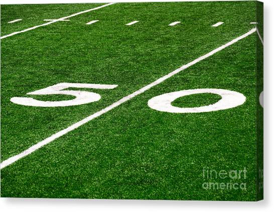 Football Canvas Print - 50 Yard Line On Football Field by Paul Velgos