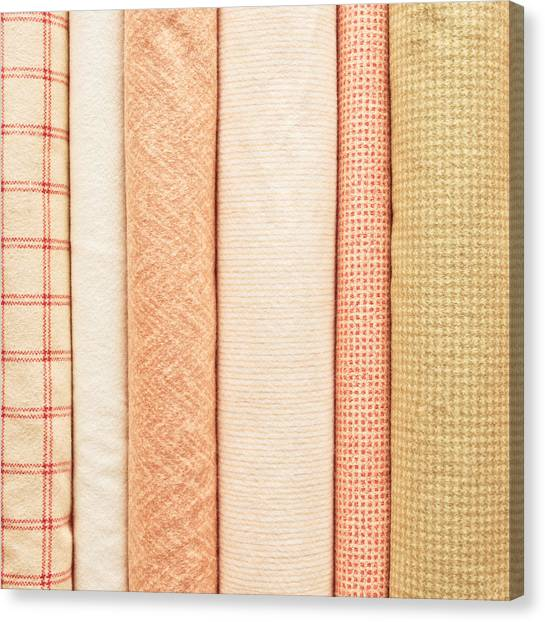 Clothing Store Canvas Print - Fabric Background by Tom Gowanlock