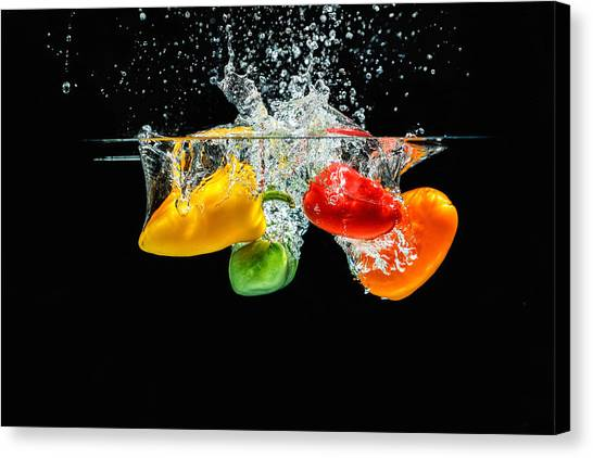 Splashing Paprika Canvas Print