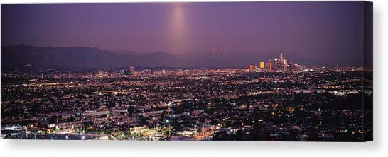 San Gabriel Canvas Print - Buildings In A City Lit Up At Dusk by Panoramic Images
