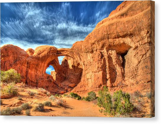 Double Arch In Arches National Park Canvas Print by Pierre Leclerc Photography