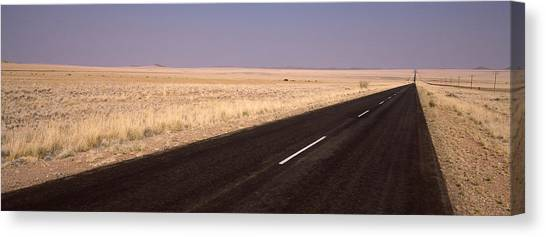 Namib Desert Canvas Print - Road Passing Through A Landscape by Panoramic Images