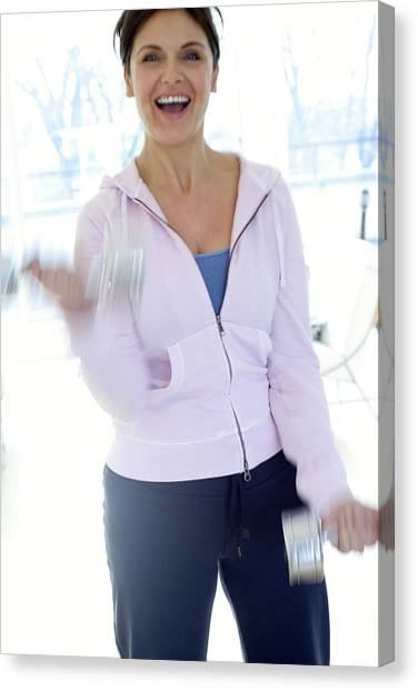 Woman Exercising Canvas Print by Ian Hooton/science Photo Library