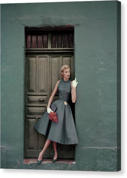 A 1950s Model Standing In A Doorway Canvas Print by Leombruno-Bodi