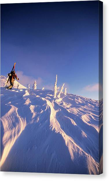 Teton National Forest Canvas Print - A Backcountry Skier Hikes by Jeff Diener