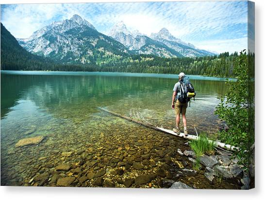 Hole In One Canvas Print - A Backpacker Staring At The Mountains by Rob Hammer