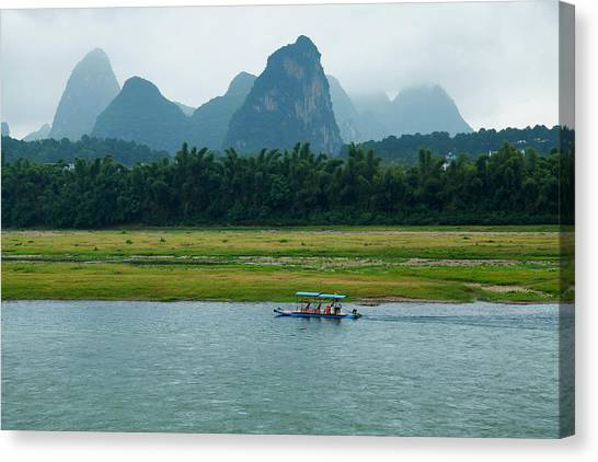 A Bamboo Raft Along The Li River In Canvas Print