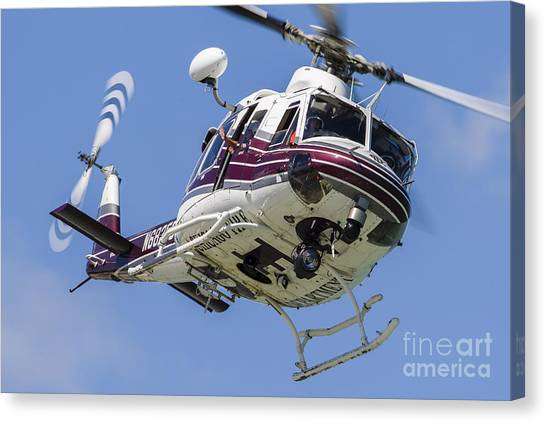 Chicago Fire Canvas Print - A Bell 412 Helicopter Flies by Rob Edgcumbe