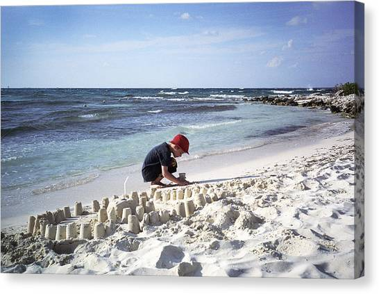 Sand Castles Canvas Print - A Boy Builds A Sand Castle by Todd Korol