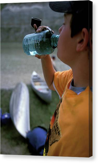 Boy Scouts Canvas Print - A Boy Drinks From A Water Bottle by Corey Rich