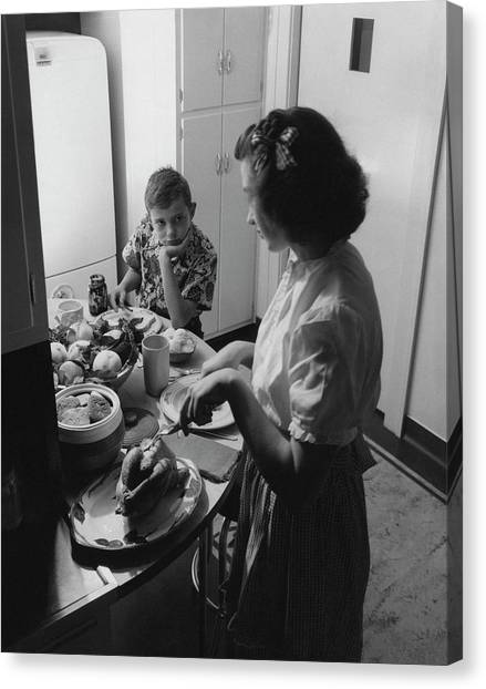 A Boy Watching His Mother Prepare Dinner Canvas Print