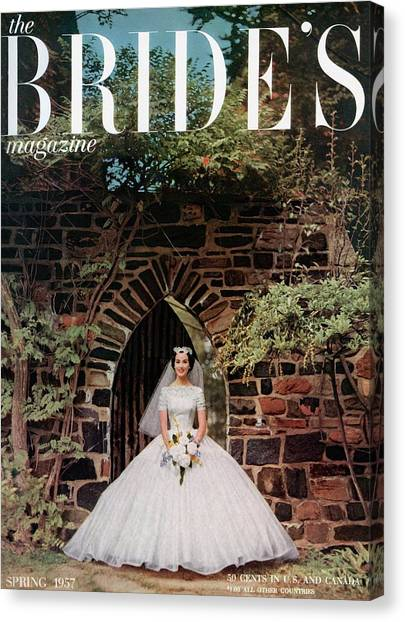 Wedding Bouquet Canvas Print - A Bride In Front Of Stone Gate by Carmen Schiavone