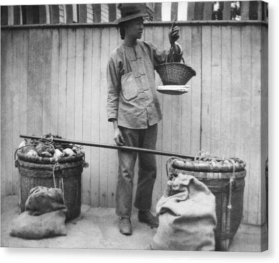 Fruit Baskets Canvas Print - A Chinese Fruit Vendor by Underwood Archives
