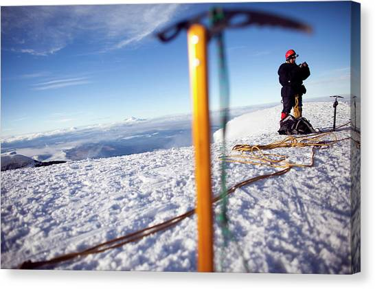 Cotopaxi Canvas Print - A Climber Looks For Signal On His Cell by Caroline Bennett