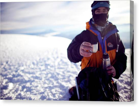 Cotopaxi Canvas Print - A Climber Offers Hot Tea From A Thermos by Caroline Bennett
