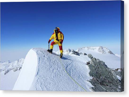Antarctica Canvas Print - A Climber On The Summit Of Mt Vinson by Peter J. Raymond