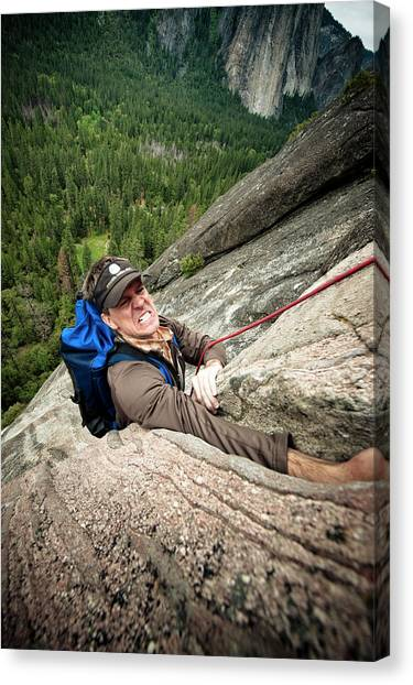 Backpacks Canvas Print - A Climber Reaches His Hand In A Crack by Kevin Steele
