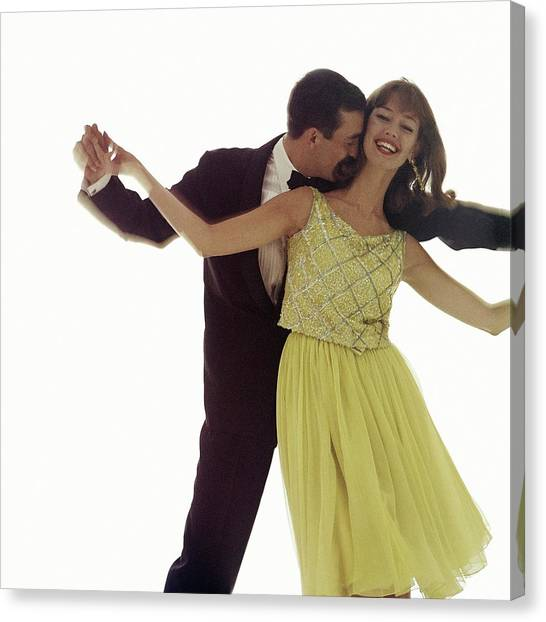 Tuxedo Canvas Print - A Couple Holding Hands by Bert Stern