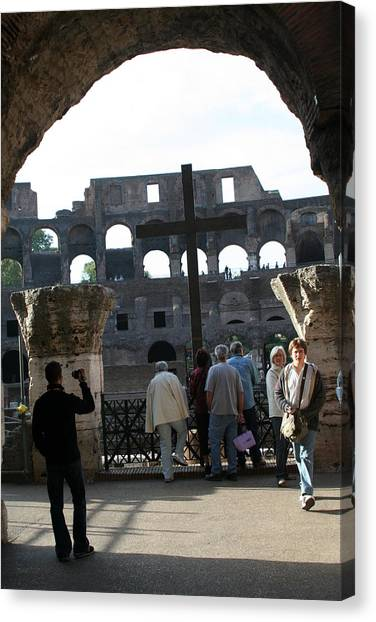 A Cross In The Coloseum Canvas Print by Dick Willis