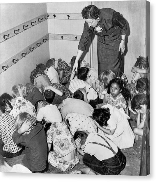 Cold War Canvas Print - A Duck And Cover Exercise In A Kindergarten Class In 1954 by Underwood Archives