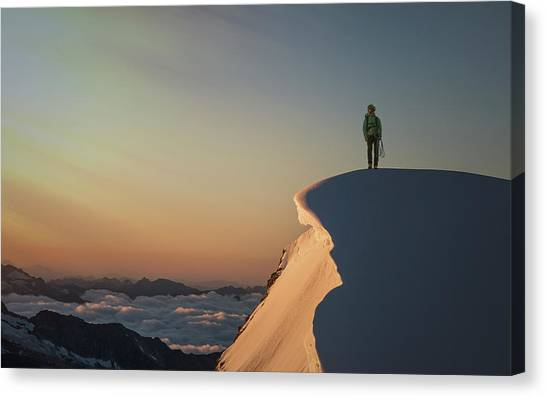 A Female Climber On A Snowy Mountaintop Canvas Print by Buena Vista Images