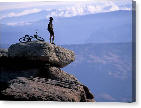 It Professional Canvas Print - A Female Mountain Biker Stands by Corey Rich