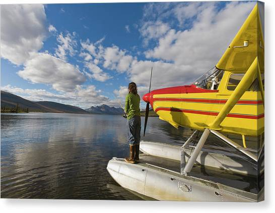 Cessnas Canvas Print - A Fisherman On A Floatplane In Scenic by Hugh Rose