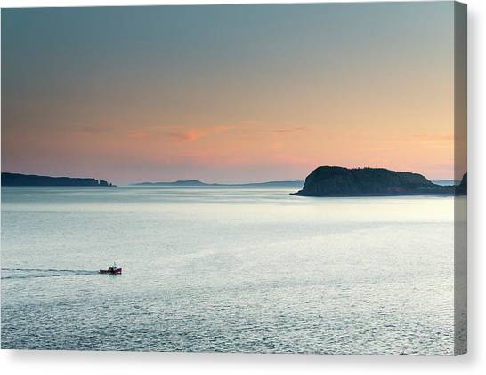 Canvas Print - A Fishing Boat Cruises Through Flat by Robbie George