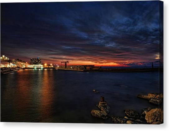 a flaming sunset at Tel Aviv port Canvas Print