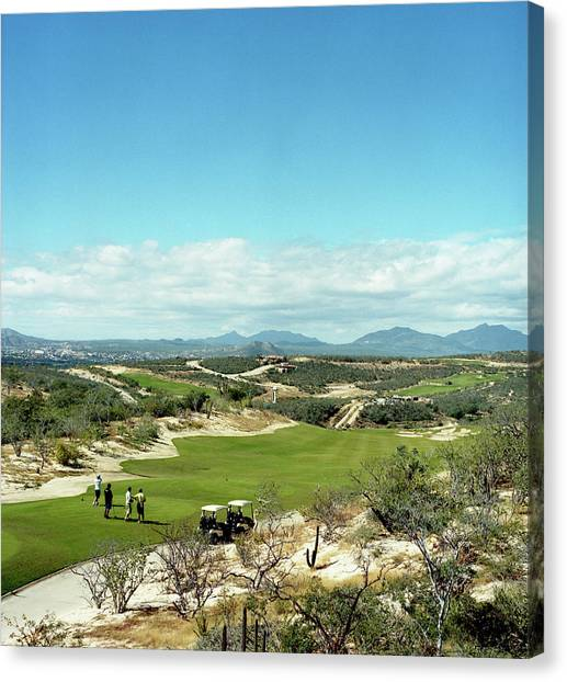 Baja California Canvas Print - A Foursome Tees Off On A Golf Course by Michael Hanson