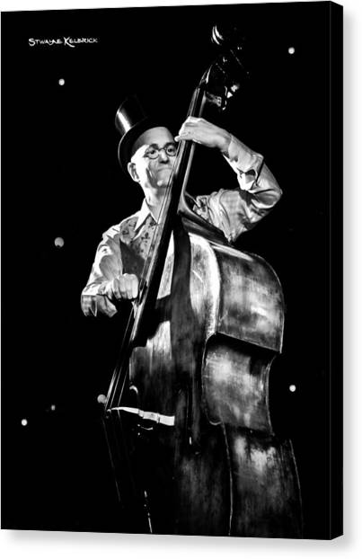 Canvas Print featuring the photograph A French Contrabass Player by Stwayne Keubrick