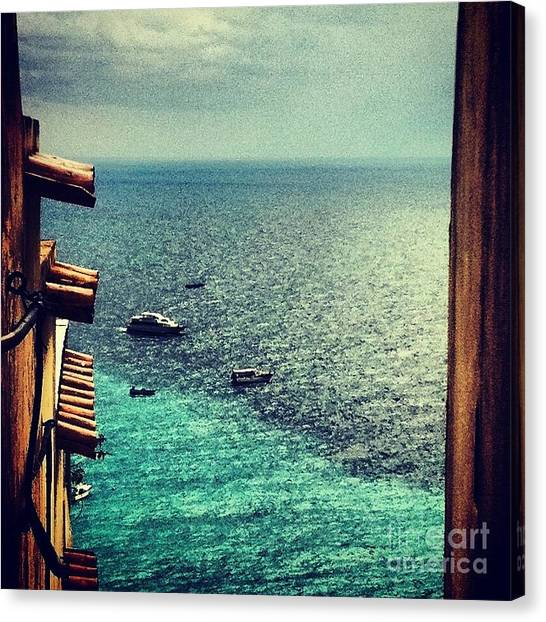 A Glimpse Of Blue Waters Canvas Print by H Hoffman
