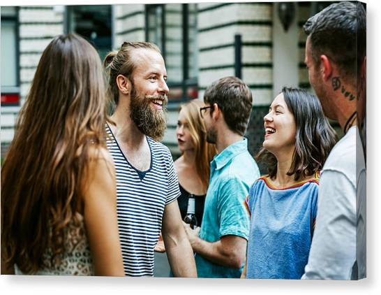 A Group Of Friends Meeting Together At Barbecue Canvas Print by Hinterhaus Productions