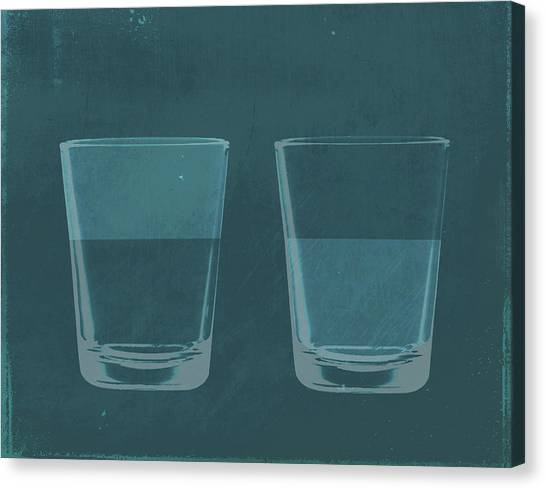 A Half Full Glass Of Water Next To A Canvas Print