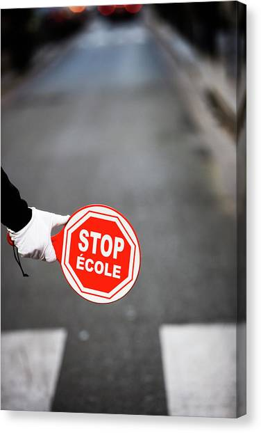 Stop Sign Canvas Print - A  Hand Holding A Stop Sign In French by Ron Koeberer