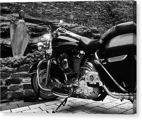 A Harley Davidson And The Virgin Mary Canvas Print