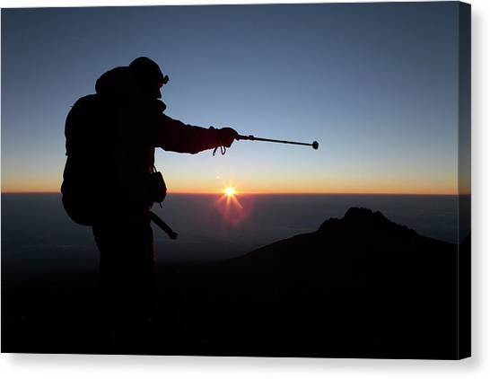 Mount Kilimanjaro Canvas Print - A Hiker Enjoying Sunrise by Menno Boermans