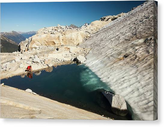 Crouching Canvas Print - A Hiker Stops Tos Wash His Hands by Christopher Kimmel
