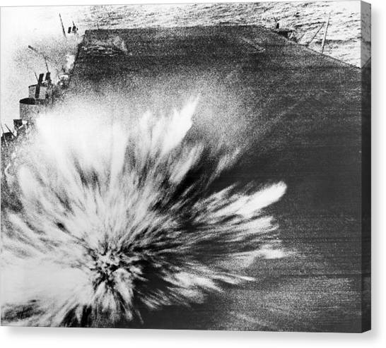 Bombs Canvas Print - A Japanese Bomb Explodes On The Flight Deck Of The Uss Enterprise by Underwood Archives